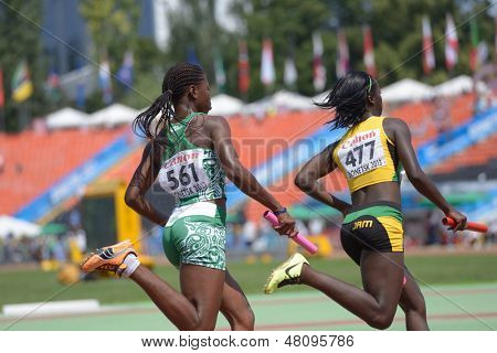 DONETSK, UKRAINE - JULY 13: Tiffany James, Jamaica (right) and Edidiong Ofonime Odiong, Nigeria compete in the medley relay during World Youth Championships in Donetsk, Ukraine on July 13, 2013