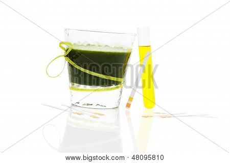 Green Drink, Ph Test Strips And Urine In Test Tube.