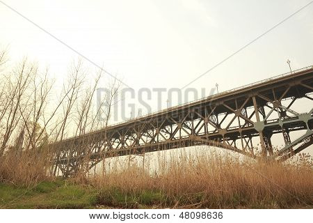 Old Steel Structure Bridge Across The Water
