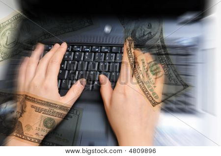 Female Hands Working On Computer With Money Around