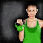 stock photo of dumbbells  - Fitness woman exercising crossfit holding kettlebell strength training biceps - JPG