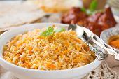 Biryani rice or briyani rice, fresh cooked, traditional indian food on dining table.