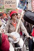 NEW YORK-MAY 25: A protestor on a bicycle strums a banjo and sings during the March Against Monsanto