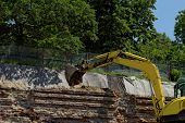 stock photo of backhoe  - the excavator working on a construction site - JPG