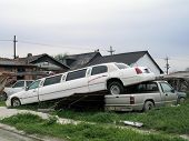 stock photo of katrina  - stretch limo still sits on a pickup truck bed seven months after hurricane katrina floods washed it there in the lower ninth ward of new orleans - JPG
