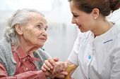 stock photo of hospice  - Senior woman with her caregiver at home - JPG