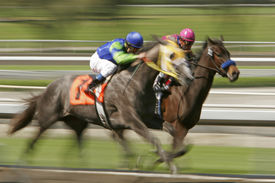 image of race track  - Slow shutter speed rendering of racin horses and jockeys - JPG