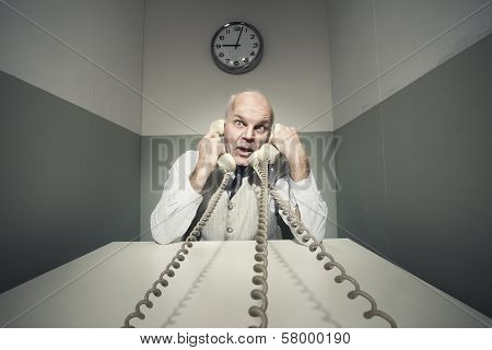 Overworked Businessman On The Phone