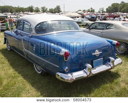 Blue Oldsmobile Ninety Eight Rear View