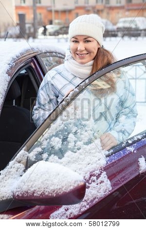 Young Woman Near The Car At Winter Season