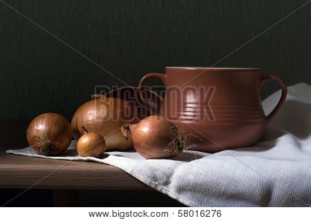 Clay Pot And Onions