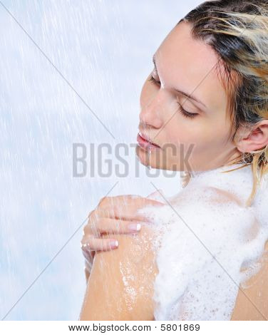 Beautiful Young Woman Standing Under Streams Of Water