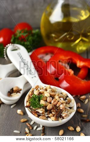 Uncooked Multigrain Rice In Porcelain Measuring Spoons With Raw Vegetable