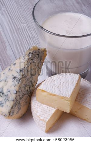 Milk In A Glass, Brie And Blue Cheese Close Up