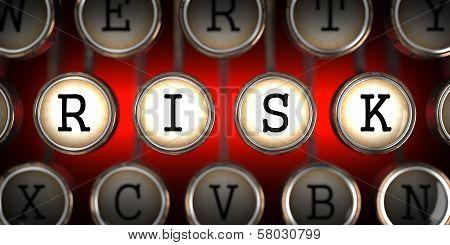 Risk on Old Typewriter's Keys.