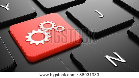 Cogwheel Gear Icon on Red Keyboard Button.