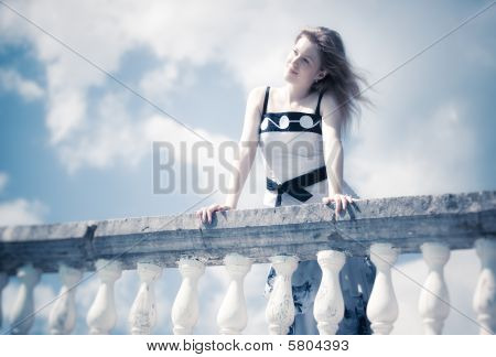 Young Romantic Woman Standing At The Railing