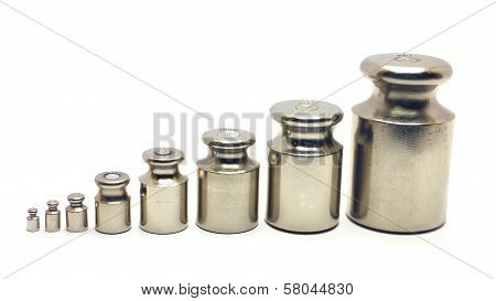 Eight Calibration Weights On White Background