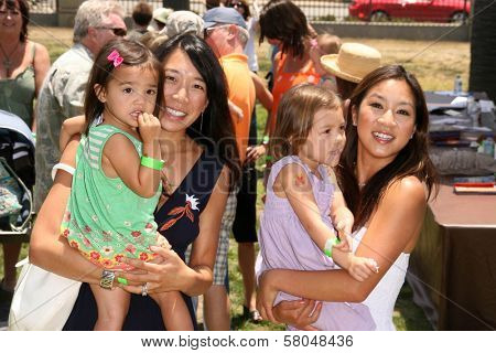 Karen Kwan and her daughters with Michelle Kwan  at