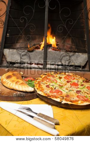 Homemade pizza served on a wooden table