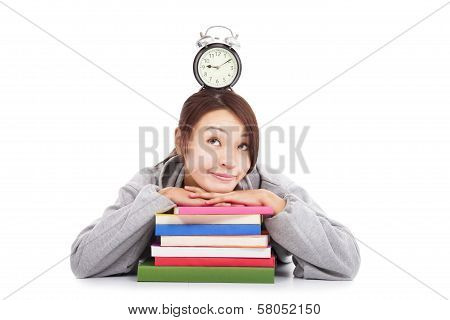 Happy Young Student Thinking  Clock With Books
