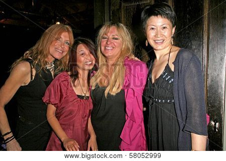 Marilyn Vance and Serena Guam with Cendra Martel and Lisa Gao  at the party celebrating the opening night of the play