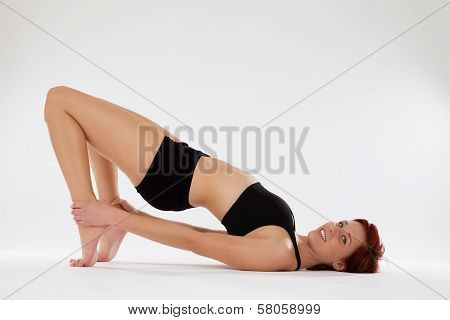 Fitness Woman Exercising Holding Her Ankles