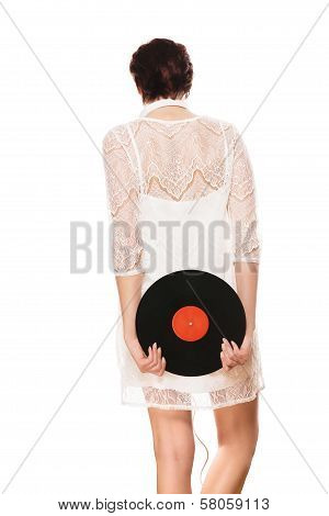 Woman Holding Record Behind Her Back