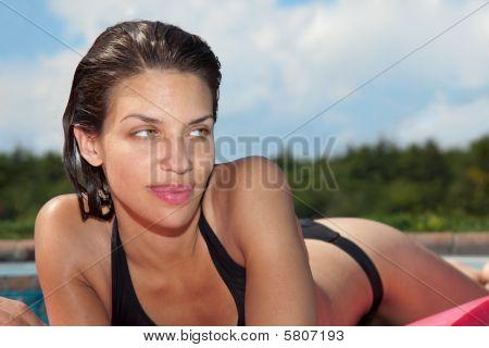 Sultry Woman In Black Bikini