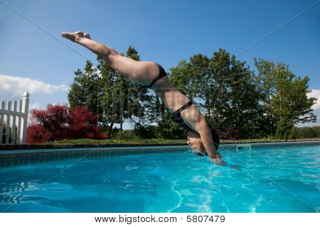 A Woman Nose-diving Into A Pool