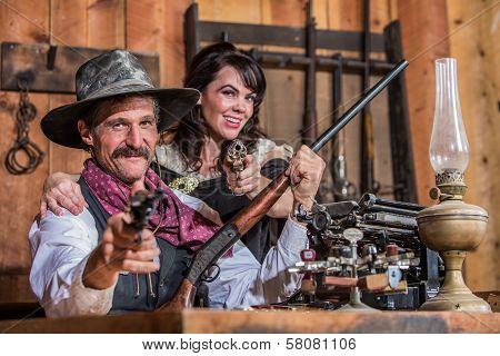 Smiling Sheriff Points Gun With Woman