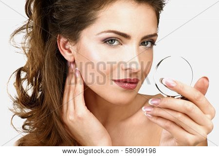 Closeup Of A Beautiful Woman Checking Her Makeup In The Mirror