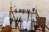 image of jousting  - medieval shields helm and weapons in a medieval fair in italy - JPG