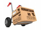 foto of hand truck  - Humanitarian Aid Slogan on Cardboard Box on Hand Truck White Background - JPG