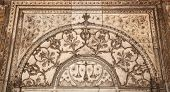 picture of khas  - Scales of justice and ethnic floral ornament on the wall in Khas Mahal Red Fort Old Delhi India - JPG
