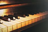 image of grand piano  - Old piano keyboard close up as a music background - JPG