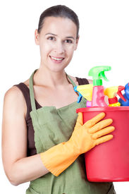 stock photo of house cleaning  - A happy young woman with cleaning equipment ready to clean  - JPG