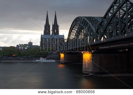 Railway Bridge On River Rhine Against Cologne Cathedral