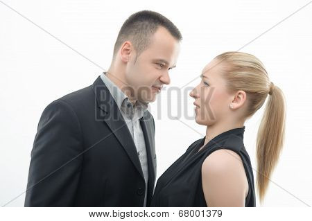 Colleagues shouting against each other on white background