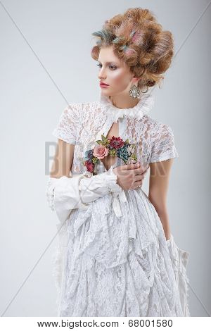 Fashion Model In Flossy White Dress And Wreath Of Flowers