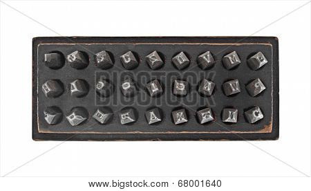 vintage metal lettering stamps punch set in a wooden box, clipping path
