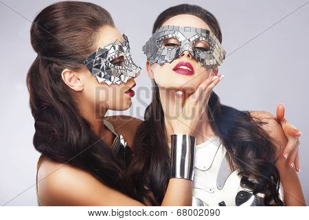 Performance. Entertainment. Women In Silver Shiny Masks. Artistry