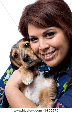 Woman Cuddling A Puppy