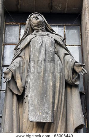PARIS, FRANCE - NOV 09, 2012: Saint Teresa, architectural details of Eglise de la Madeleine. Madeleine Church was designed in its present form as a temple to the glory of Napoleon's army.