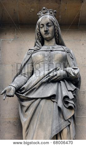 PARIS, FRANCE - NOV 09, 2012: Saint Adelaide of Italy, architectural details of Eglise de la Madeleine. Madeleine Church was designed in its present form as a temple to the glory of Napoleon's army.