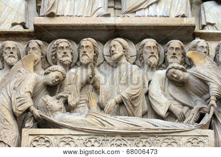 PARIS,FRANCE - NOV 05,2012:Death of the Virgin Mary,architectural details of Notre Dame cathedral.The Portal of the Virgin,dedicated to the patroness of the cathedral, was sculpted in the 1210s-1220s.