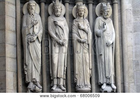 PARIS, FRANCE - NOV 05, 2012: St Paul, King David, a queen, king, architectural details of Notre Dame cathedral. Portal of St. Anne was the first of the three west portals to be installed (c.1200).