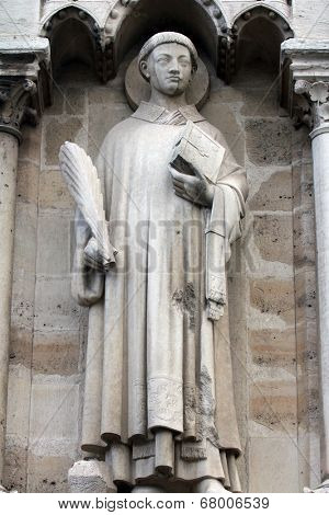 PARIS, FRANCE - NOV 05,2012: Saint Stephen, architectural detail of Cathedral Notre Dame de Paris, most famous Gothic, Roman Catholic cathedral (1163-1345) on eastern half of Cite Island. France