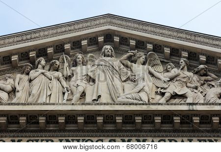 PARIS, FRANCE - NOV 09, 2012: The sculpted tympanum of Eglise de la Madeleine. Madeleine Church was designed in its present form as a temple to the glory of Napoleon's army.
