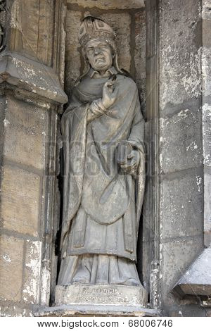 PARIS, FRANCE - NOV 11, 2012: Saint Alode statue, Church of St-Germain-l'Auxerr ois founded in the 7th century, was rebuilt many times over several centuries.